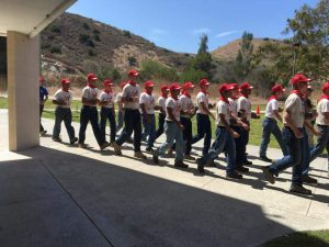 Kids from the Devil Pups' program walking outside